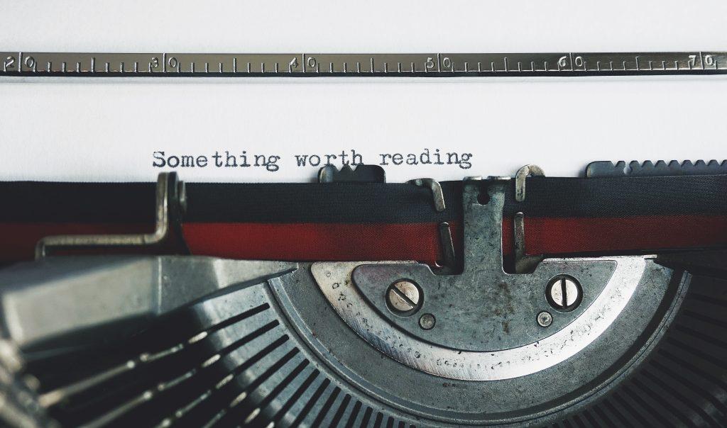 something worth reading text on typewriter